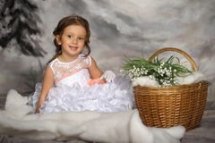 Girl with may-lilies Royalty Free Stock Photo