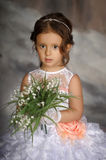 Girl with may-lilies Stock Images
