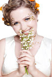 Girl with may lily flowers Stock Photography