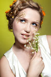 Girl with may lily flowers Royalty Free Stock Photos