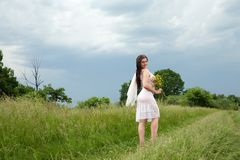 Girl on meadow Royalty Free Stock Photo