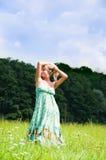 Girl on meadow Stock Image