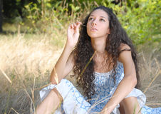 Girl on the meadow Stock Photography