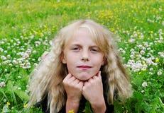 Girl in the meadow. Stock Photos