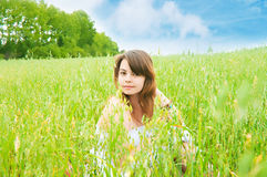 The girl on a meadow Stock Images