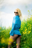 Girl on meadow Stock Photography