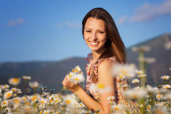 Girl on the meadow Royalty Free Stock Photos