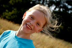 Girl on a meadow Royalty Free Stock Photo