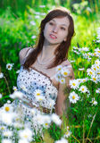 Girl on a meadow Stock Image