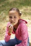 Girl on meadow Stock Photo