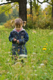 Girl at the meadow. Small girl thoughtful stay at the meadow stock photography