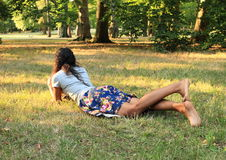 Girl on meadow Stock Photos