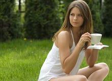 Girl in a meadow enjoying the sun.  stock image