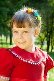 Girl  on the meadow in spring day Stock Photography
