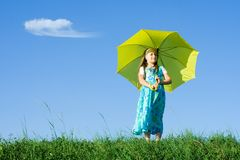 Girl at meadow with umbrella Stock Photography