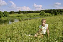 Girl on meadows Royalty Free Stock Photos