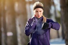 Girl measure pulse on cardio training outdoor Stock Photo