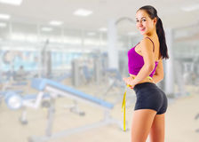 Girl with measurement tape at fitness club Royalty Free Stock Photo