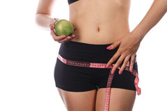 Girl measures buttocks and holding an apple. Stock Images