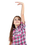 The girl measures the growth of its Royalty Free Stock Image