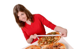 Girl measures the size of Pizzi. Girl in a red sweater measures the size of Pizzi stock photo