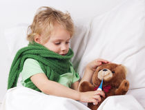 Sick girl and teddy bear Royalty Free Stock Photography