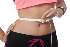 Girl measures the waist with meter Stock Photos