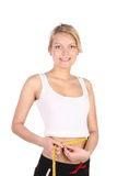 Girl measures waist volume. The growing thin concept Royalty Free Stock Photography