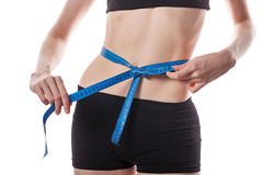 Girl measures the waist. Weight loss. Royalty Free Stock Photo