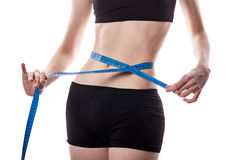 Girl measures the waist. Weight loss. Royalty Free Stock Photography