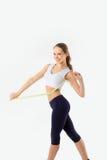 Girl measures a waist on a white background. Healt Stock Photo