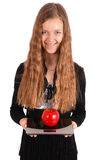 Girl measures the weight of apples Royalty Free Stock Photos