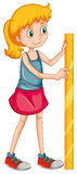 Girl measuring height with a ruler Stock Photo