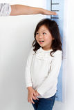 Girl measuring height Royalty Free Stock Photography