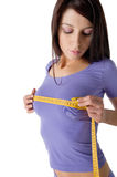 Girl measuring her perfect breast Royalty Free Stock Photography