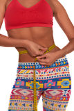 Girl measuring her waist with soft meter isolated Stock Photo