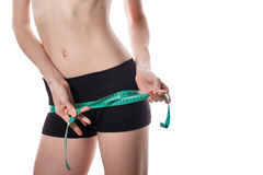Girl measuring hip. Weight loss. Stock Photography