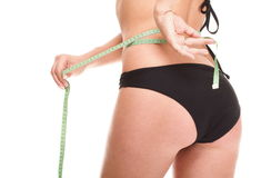 Girl measuring, perfect shape of beautiful thigh. Studio Stock Images