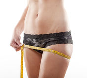 Girl measuring results of diet Stock Image