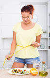 Girl with measuring tape Stock Photography