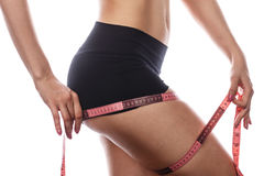 Girl measuring tape thigh. royalty free stock photo