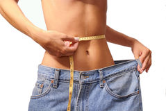 Girl measuring waist Royalty Free Stock Images