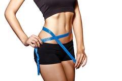 Girl measuring waist Stock Images