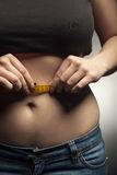 Girl measuring waist measuring tape. Diet results. teenager in j Royalty Free Stock Photos