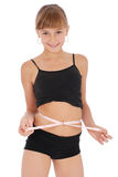 Girl measuring waist with tape measure Royalty Free Stock Image