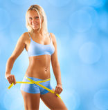 A girl measurong waist Royalty Free Stock Images
