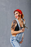 Girl mechanic holding a hand vise. Royalty Free Stock Photos
