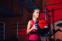 Girl with med ball Stock Photos
