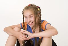 Girl with a mediaplayer III Stock Image