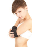 Girl in medical bandage, elbow support Royalty Free Stock Images